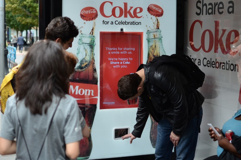 A smile activated can dispenser that features as part of the Share a Coke campaign